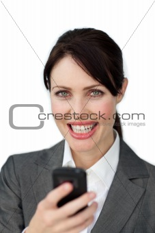 Attractive businesswoman sending a text against