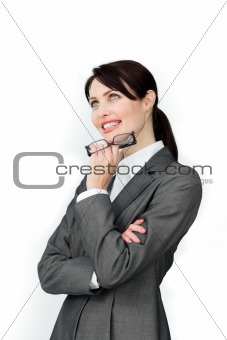 Positive businesswoman holding glasses