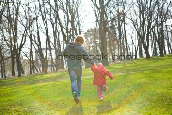 Father and daughter running