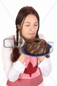 beautiful housewife smelling bundt cake