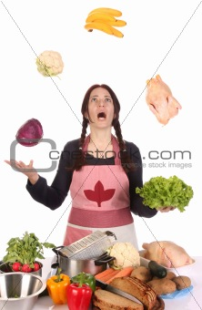 housewife juggling with fruit and vegetables