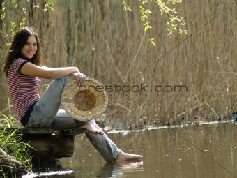Girl resting near lake