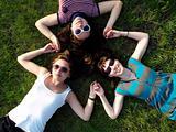 Girls laying on grass