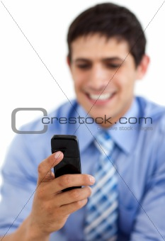 Smiling businessman sending a text