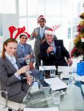Manager and his team toasting with Champagne at a Christmas part