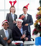 Delighted Businessman team celebrating christmas