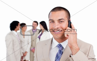 Portrait of caucasian businessman on phone with his team