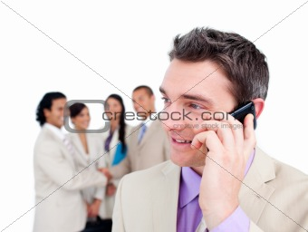 Charming businessman talking on phone