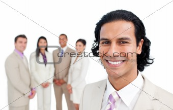 Portrait of latin businessman smiling with his team