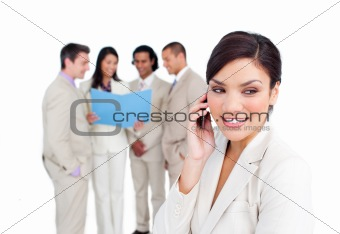 Portrait of an elegant businesswoman on phone with her team
