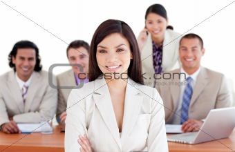 Assertive businesswoman with her team in the background