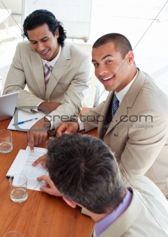 Smiling business co-workers in a meeting
