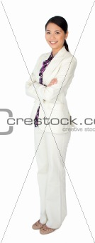 Attractive asian businesswoman standing with folded arms