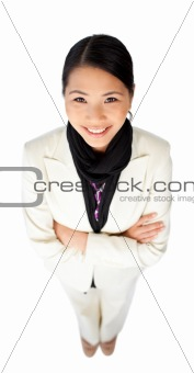 Confident ethnic businesswoman with folded arms