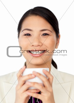 Charming businesswoman drinking coffee