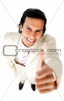 Smiling young businessman with thumb up