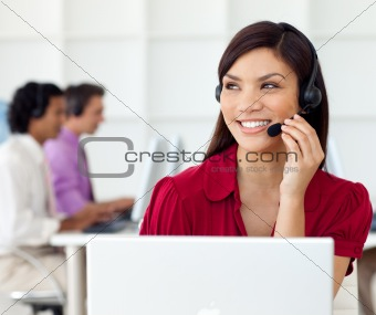 Charming Businesswoman talking on headset