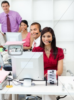 Smiling business people with headset on working
