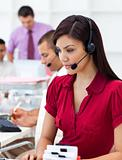 Concentrated Businesswoman using headset