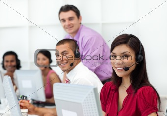 Positive business people with headset on working