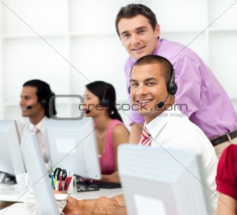 Assertive manager checking his employee's work in