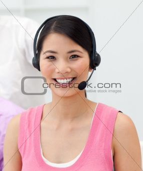 Charming young businesswoman talking on headset