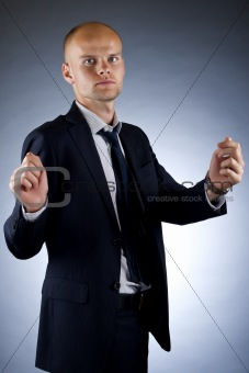 businessman holding an imaginary sign