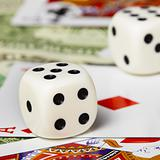 Dice against cards and money