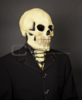 Portrait of death in business suit