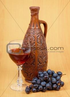 Ceramic jug and a glass