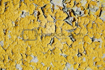 Texture of old wall with peeling yellow paint