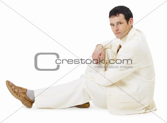 Man in light business suit siting on white