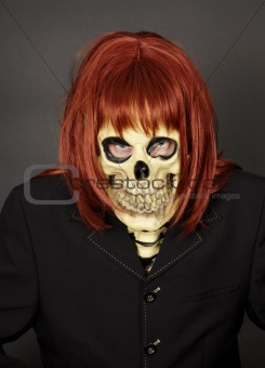 Masked man - skeleton in red wig