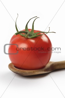 Tomato in wooden spoon