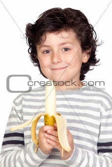 Beautiful child eating a banana