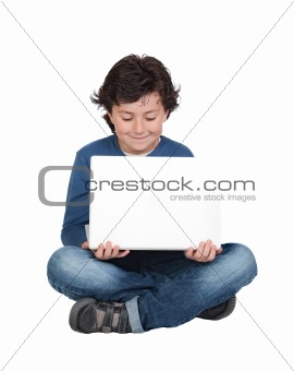 Adorable little boy sitting with laptop