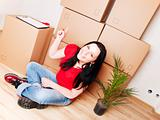 woman moving to new house and pointing carton