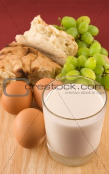 Fresh bread with eggs  and glass of milk
