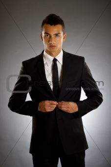 businessman buttons up