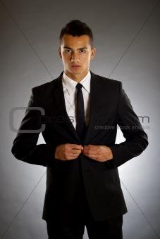 businessman buttons up