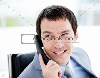 Assertive young businessman talking on phone