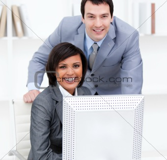 Beautiful colleagues working together at a computer