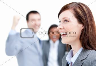 Laughing businesswoman standing with her team against a white ba