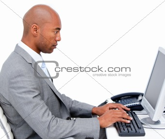 Serious businessman working at a computer