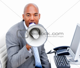 Angry businessman yelling through a megaphone