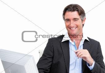 Cheerful businessman working at a computer