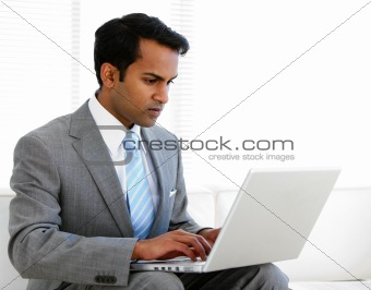 Self-assured businessman working on his computer