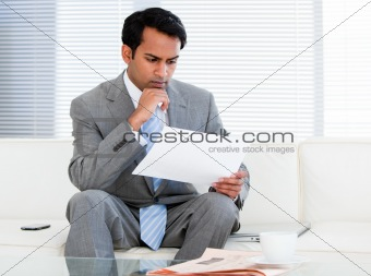 Confident businessman reading a note