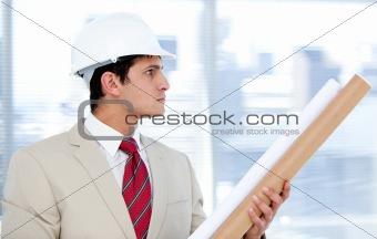 Caucasian architect holding a blueprint