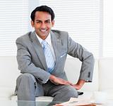 Handsome businessman sitting on the sofa